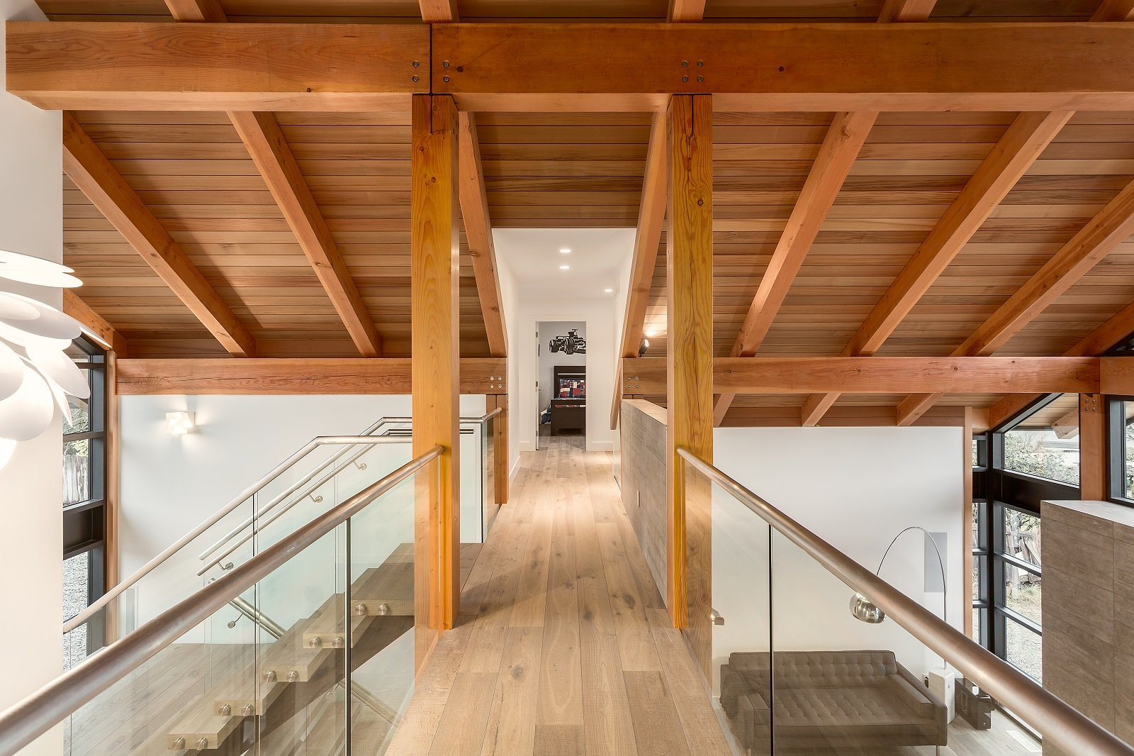 Whistler Custom Home by Coast Construction. Upstairs walkway of Roslyn Boulevard Home.