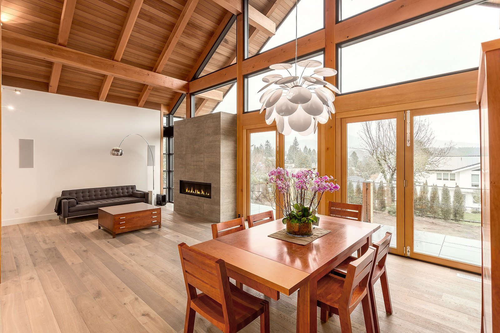 Whistler Custom Home by Coast Construction. Living room and dining room of Roslyn Boulevard Home.